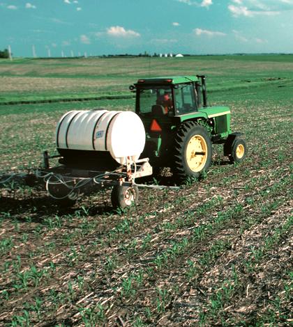 A farmer applies nitrogen fertilizer to a corn field in Iowa (Credit: U.S. Department of Agriculture)