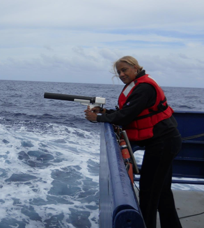 Jacquelyn Hams aboard the R/V Revelle in the Indian ocean with an XBT, a torpedo gun-like instrument for measuring ocean thermoclines