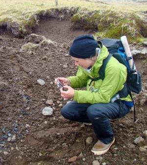 Caroline Funk examines a site on Kiska Island (Credit: University at Buffalo)