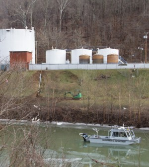 An environmental enforcement boat patrols in front of the chemical spill at Freedom Industries (Credit: Foo Conner, via Flickr)