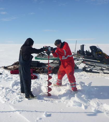 Sampling an Arctic lake (Credit: Ben Jones)