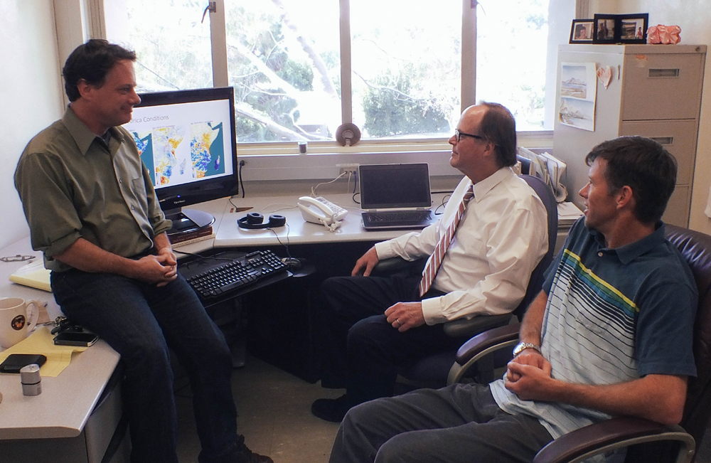 Chris Funk, Joel Michaelsen, Greg Husak (left to right) in Funk's office looking at CHIRPS data.  (Credit: USGS)