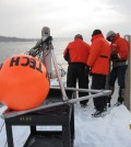 A crew deploys the under-ice observatory in the Portage Waterway (Credit: Guy Meadows)