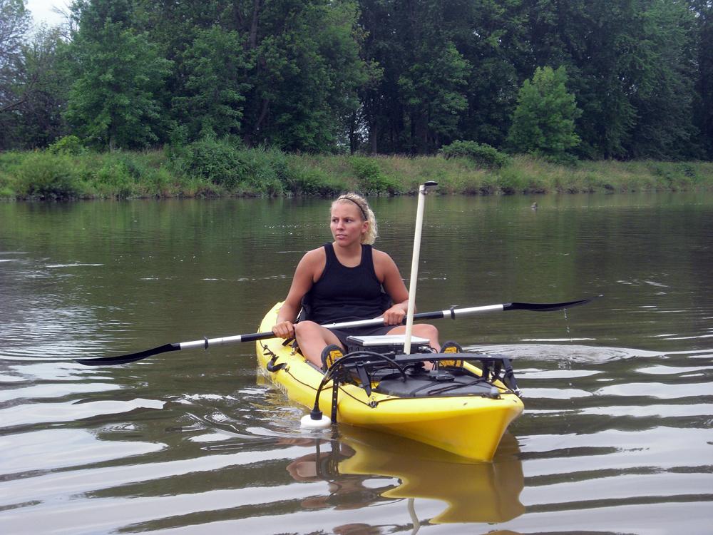 Aubrey Scott in her kayak equipped with flow-sensing instruments (Credit: Andrea Dominguez)