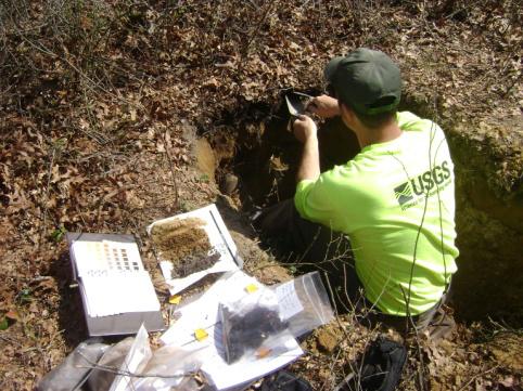 USGS scientist Jason Siemion sampling soils in Riverhead, N.Y. (Credit:Greg Lawrence)
