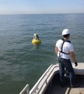 The GLERL crew deploying one of the new small experimental buoys on Lake Erie (Credit: NOAA GLERL)