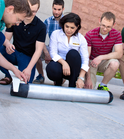 Nina Mahmoudian and students from her lab along with the ROUGHIE glider prototype. (Credit: Sarah Bird/Michigan Tech)