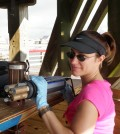 Danielle Doremus at work with a multi-parameter water quality sonde (Credit: Scott Kindelberger)