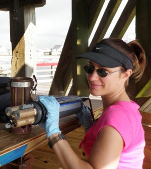 Danielle Doremus at work with a multi-parameter water quality sonde (Credit: Scott Kindelberger)