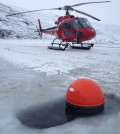 Researchers used a helicopter and boat to deploy 14 drifters between 2011 and 2013. (Credit: Kunuk Lennert, Greenland Climate Research Center)