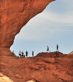 Visitors in Arches National Park in Moab, Utah (Credit: Emilio Labrador, via Flickr)