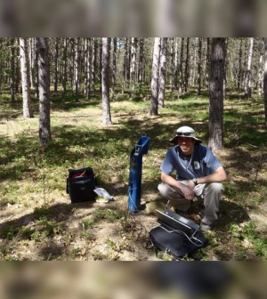 Former USI undergrad Chanse Ford at savanna restoration monitoring site in the Mansitee National Forest, Michigan. (Credit: Paul Doss)