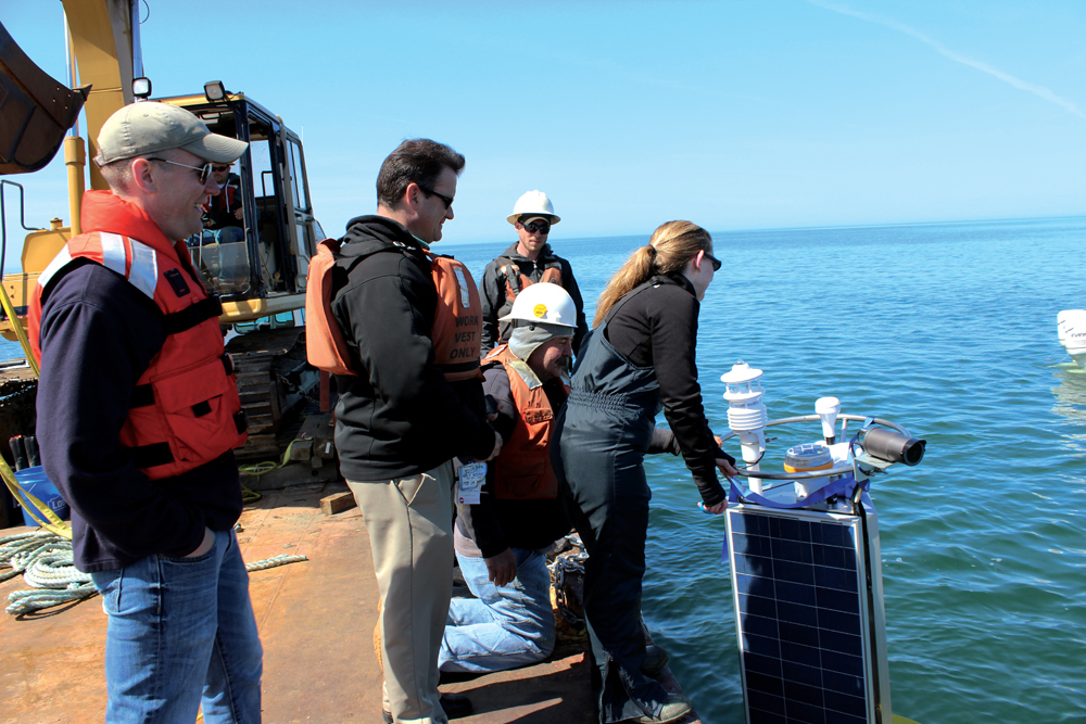 Jeanette Schnars cuts the ribbon at the buoy's first deployment in May (Credit: Doug Nguyen/NexSens Technology)