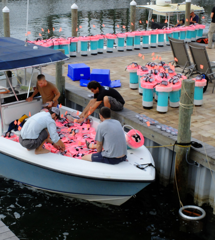 Loading up current-tracking GPS drifters for use in the Gulf of Mexico (Credit: Tamay Özgökmen)