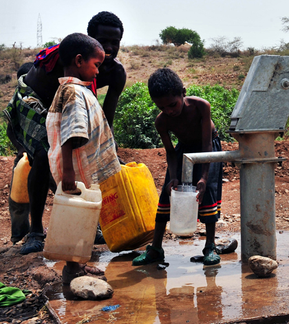 Gathering water from a recently completed fresh water well in Dira Dawa, Ethiopia (Credit: U.S. Navy, via Flickr)