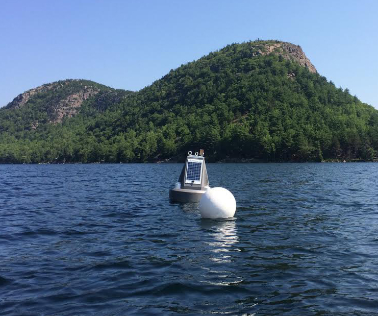 """The Jordan Pond buoy floats near a few hills known locally as the """"Bubbles."""" (Credit: Nora Theodore)"""
