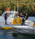 A crew launches one of five water quality profilers planned for Lake George. (Credit: Rensselaer Polytechnic Institute)