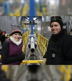 Researchers with the Deep Ice Sheet Coring Drill. (Credit: Jay Johnson)