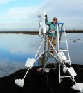 Jaclyn Matthes cleaning the eddy flux tower shortly after it was installed at the newly flooded wetland in winter 2010. (Credit: Joe Verfaillie)