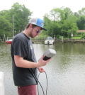A student samples Mill Creek (Courtesy of Sally Hornor)