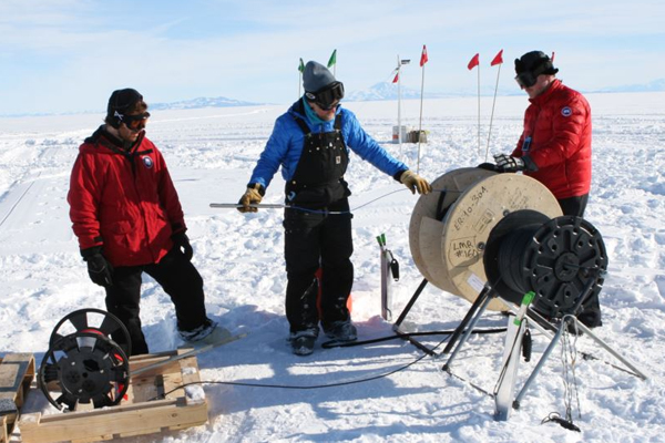Fiber optic cables and pressure sensors were lowered down into holes drilled in the ice. (Credit: Victor Zagorodnov)