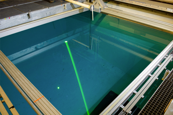 GTRI researchers use the lidar system to study the best methods for producing accurate images of objects on the pool floor. (Credit: Rob Felt)