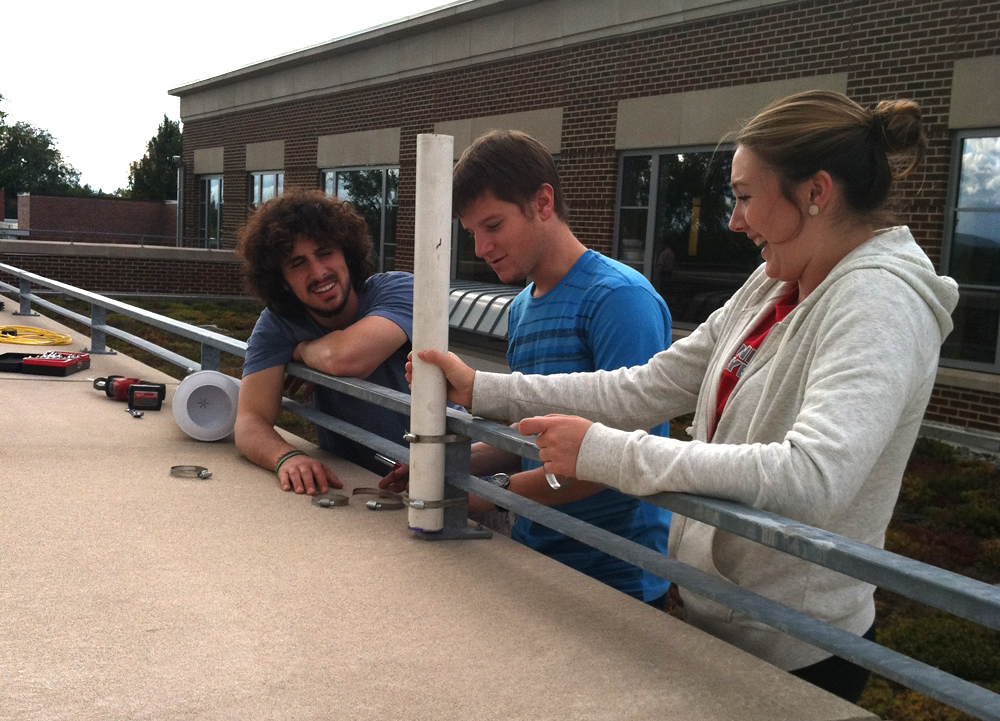 Muhlenberg students installing a rain gauge for the green roof monitoring system. (Credit: David Rabold)