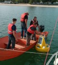 A Niagara Region crew deploys a water quality data buoy at one of the beaches the test for swimmer safety. (Credit: Doug Nguyen)