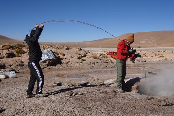 Researchers run temperature and pressure sensors down a geyser in Chile. (Credit: University of California, Berkeley)
