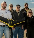 Scientists at the Wright State Research Institute display one of their UAS aircraft. (Credit: Wright State University)