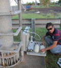 Chilean meteorologist collects air samples for NOAA's Global Greenhouse Gas Monitoring Network. (Credit: NOAA)