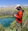 Doctoral candidate Jorge Ramos collects a water sample. (Credit: Sandra Leander)
