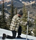 John Mickey, a field technician, takes a snowpack measurement. (Credit: National Center for Atmospheric Research)