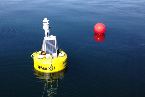A new data buoy serves as the core of the monitoring system in West Okoboji Lake. (Credit: Doug Nguyen / NexSens Technology)