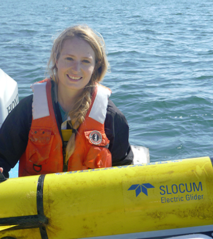 Danielle Haulsee, a doctoral student in the College of Earth, Ocean, and Environment at University of Delaware, with an underwater robot used to track sand tiger sharks. (Credit: University of Delaware)