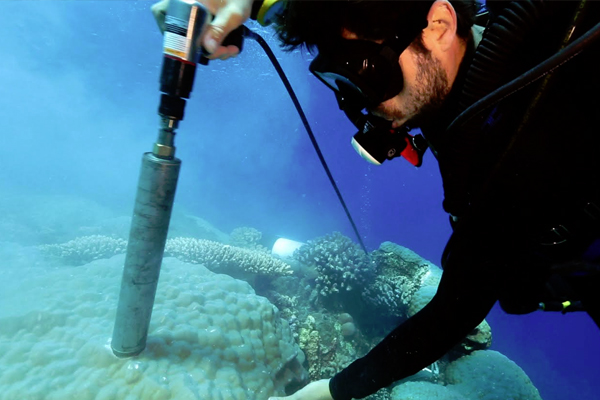 Ian Enochs collects a sample of coral reefs near the Maug Islands. (Credit: Stephani Gordon / Open Boat Films / NOAA)