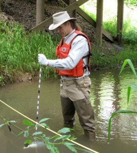 A USGS scientist samples a stream for neonicotinoid concentrations as part of the first national-scale investigation of these insecticides. (Credit: Hank Johnson / USGS)
