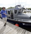 Thomas Bridgeman, associate professor of ecology at the University of Toledo, showed the new research vessel during a dedication ceremony. (Credit: Amy E. Voigt / The Blade)