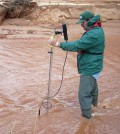 A USGS hydrographer measures flow in Short Creek after the flood event. (Credit: Jake Benson / USGS)