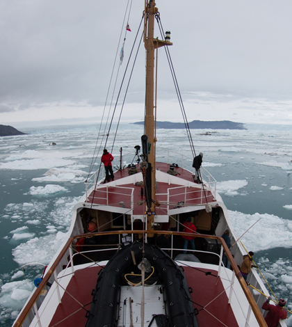 University of California, Irvine glaciologists aboard the Cape Race, in August 2014, map remote Greenland fjord bottoms and glacier melt that's raising sea levels around the globe. (Credit: University of California, Irvine)
