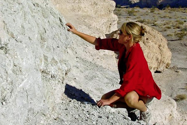 Kathleen Springer inspects wetland deposits. (Credit: Eric Scott)