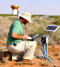 Laureano Gherardi, an ASU School of Life Sciences postdoctoral research associate, takes measurements during a six-year study on grasslands and the effects of weather extremes. (Credit: Osvaldo Sala / Arizona State University)