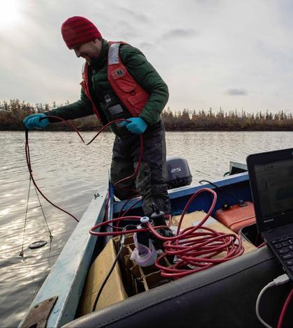 arctic ocean / Paul Mann, Northumbria U., takes biochar samples using a research boat, Kolyma River, Siberia. (Credit: Aron Stubbins)