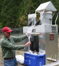 Monitoring sites like this one in Oregon maintained by the U.S. Forest Service collect precipitation samples which are then analyzed for mercury, sulfate, nitrate, and other pollutants. (Credit: Mark Brigham / U.S. Geological Survey)