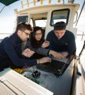 Students test their underwater wireless network in Lake Erie. (Credit: Douglas Levere / University at Buffalo)