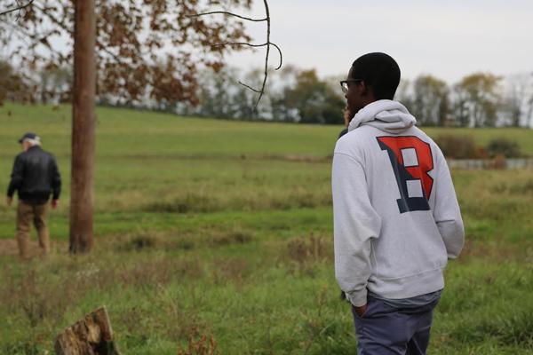 A Bucknell University student observes a farm field. (Credit: Bucknell University)