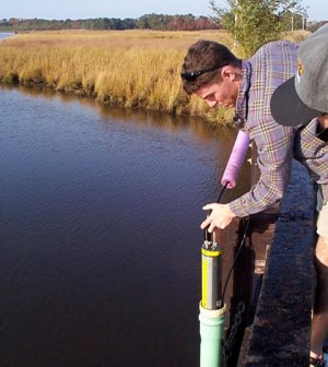 A field biologist with the Maryland Department of Natural Resources deploys a YSI water quality sonde. (Credit: Brian Smith / Maryland Department of Natural Resources)