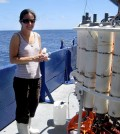 Angela Knapp stands next to a niskin rosette that was used to take water samples at various depths in the eastern South Pacific Ocean. (Credit: Florida State University)