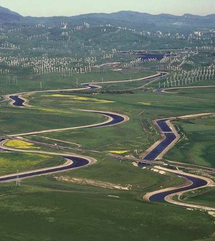 The California Aqueduct (left) and the Delta-Mendota Canal (right) wind through California's Central Valley. (Credit: U.S. Department of the Interior)