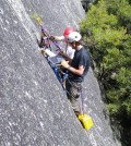 Yosemite National Park Geologist Greg Stock and U.S. Geological Survey Research Civil Engineer Brian Collins download data from instruments measuring how much granitic exfoliation sheets move from daily temperature variations as a precursor to rock falls in the park. (Credit: Valerie Zimmer / U.S. Geological Survey)